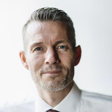 A photograph of Dennis R Mortensen.