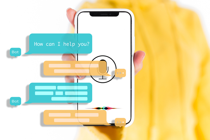 Chatbot Feedback Loops. A photograph of a hand holding a smartphone displaying a microphone symbol. Overlaid on the image is a conversation of a bot with an unknown person. The bot begins the conversation by asking How can I help you?
