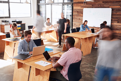 People in an open office seated at desks.